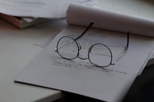 Eye Glasses sitting on a stack of papers