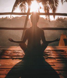 Woman Meditating on a Porch